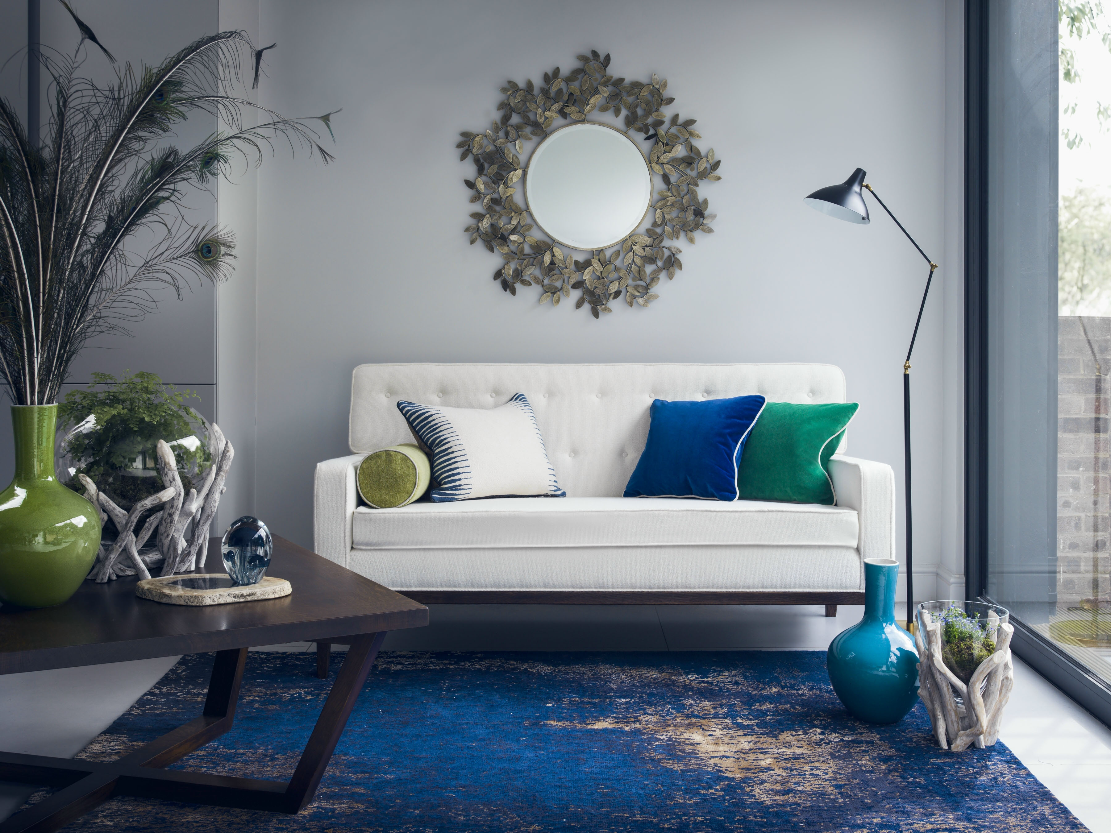 blue rug with white sofa