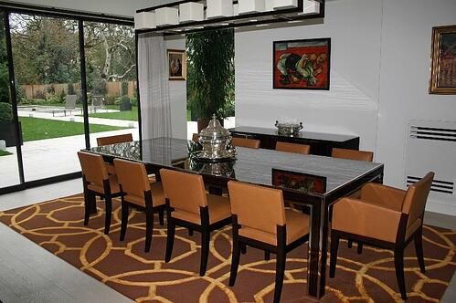 brown geometric rug in dining room